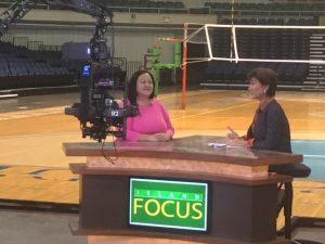 Photo of Roxanne being interviewed on Island Focus