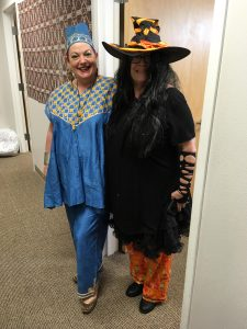 Photo of Sam and Emily dressed in Halloween costumes