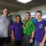 Photo of Brian, Lani, and Kathleen with Governor Ige