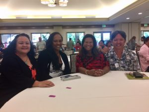 Photo of Roxanne, Julie, Lani, and Tom at the Homelessness Conference