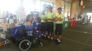 Photo of Pauline and boys at Hilo Housing Fair