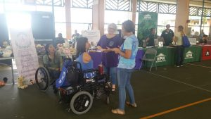 Photo of Emily talking to folks at Hilo Housing Fair