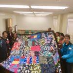 Photo of Liv Zen group holding elephant blanket