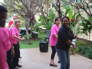 Photo of Lani line dancing with group