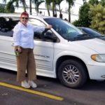 Photo of Sam standing next to donated van