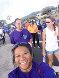 Photo of Lani selfie with Brian and Kathleen in background